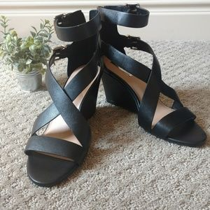 Black wedge strap buckle shoes